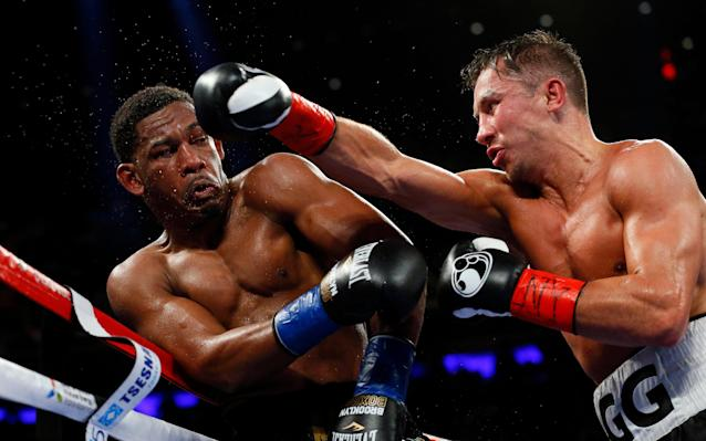 <span>Gennady Golovkin throws a punch at Daniel Jacobs during middleweight world championship fight at Madison Square Garden</span> <span>Credit: AP </span>