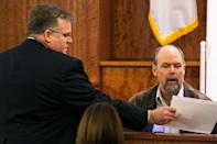 Home electronics contractor Mark Archambault (R) reviews an exhibit with Assistant District Attorney Roger L. Michel Jr. during the murder trial for former NFL player Aaron Hernandez at the Bristol County Superior Court in Fall River, Massachusetts, February 17, 2015. REUTERS/Dominick Reuter (UNITED STATES - Tags: CRIME LAW)
