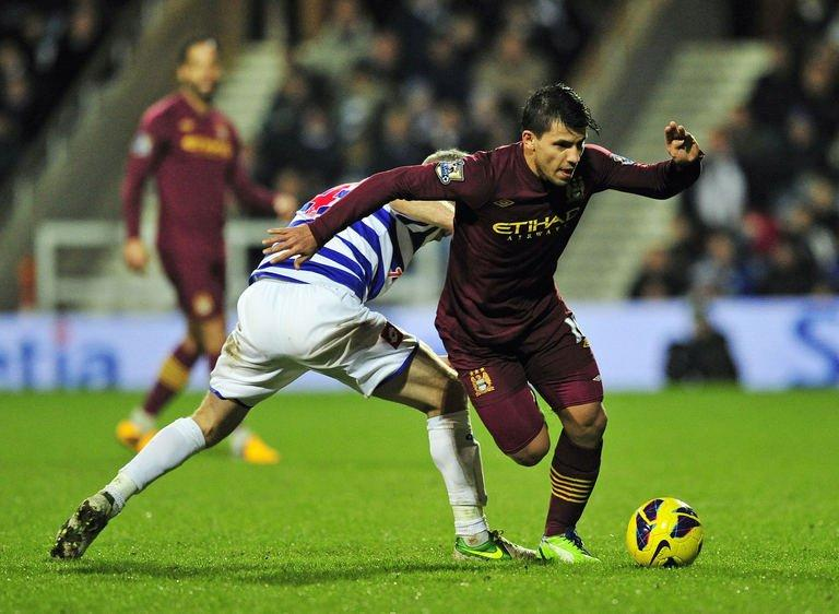 Manchester City's Sergio Aguero (R) vies with Queens Park Rangers' Shaun Derry (L) in London on January 29, 2013