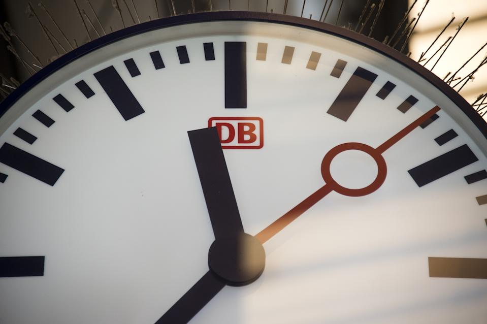 The logo of German nationwide railway operator Deutsche Bahn (DB) is seen on a clock at a station in downtown Berlin on November 5, 2014 on the start of German train drivers' longest strike in 20 years. The GDL train drivers' union called the strike -- the sixth walkout since September -- starting with freight services on November 5, 2014 afternoon and spreading to passenger services on November 6. The stoppage is scheduled to last until early Monday next week, meaning it will hit the weekend celebrations of the 25th anniversary of the fall of the Berlin Wall, where as many as two million visitors were expected to travel to the German capital.   AFP PHOTO / JOHN MACDOUGALL        (Photo credit should read JOHN MACDOUGALL/AFP via Getty Images)