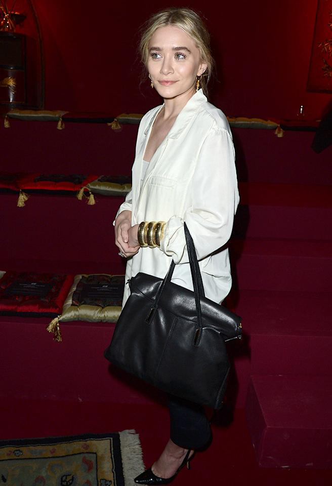 Could Ashley Olsen wear clothing that flattered her any less? More importantly, do you think Mary-Kate is hiding in that enormous handbag? (2/27/2013)