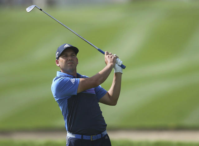 FILE - In this Saturday, Jan. 26, 2019 file photo, Sergio Garcia of Spain plays a shot on the 14th hole during round three of the Dubai Desert Classic golf tournament in Dubai, United Arab Emirates. Golf barely got out of January when it was hit with what must feel like a two-shot penalty. Odds are the negative attention on the new set of modern rules will have subsided before those four glorious days in April during the Masters unless, of course, the next man in a green jacket makes his final putt with the flagstick in the cup. (AP Photo/Kamran Jebreili, File)