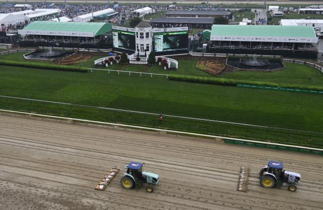 <p>Tractors groom the track before the 144th running of the Kentucky Derby at Churchill Downs in Louisville, Ky., May 5, 2018. (Photo: Jamie Rhodes/USA TODAY Sports/Reuters) </p>