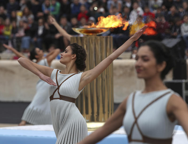 Dancers dressed as priestesses perform during a handover ceremony for the Olympic Flame at Panathenaic stadium in Athens, on Tuesday, Oct. 31, 2017. The South Korean leg of the relay will involve 7,500 torch-bearers, who will cover a total 2,018 kilometers (about 1260 miles) before the opening ceremony in Pyeongchang, which will host the Feb. 9-25, 2018 Winter Olympics. (AP Photo/Petros Giannakouris)