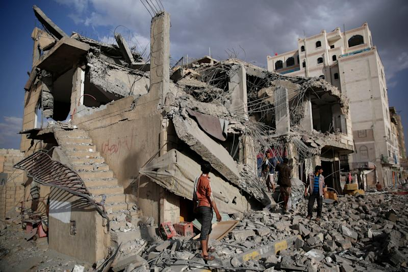 Men inspect a house destroyed by a Saudi-led airstrike in Sanaa, Yemen: AP