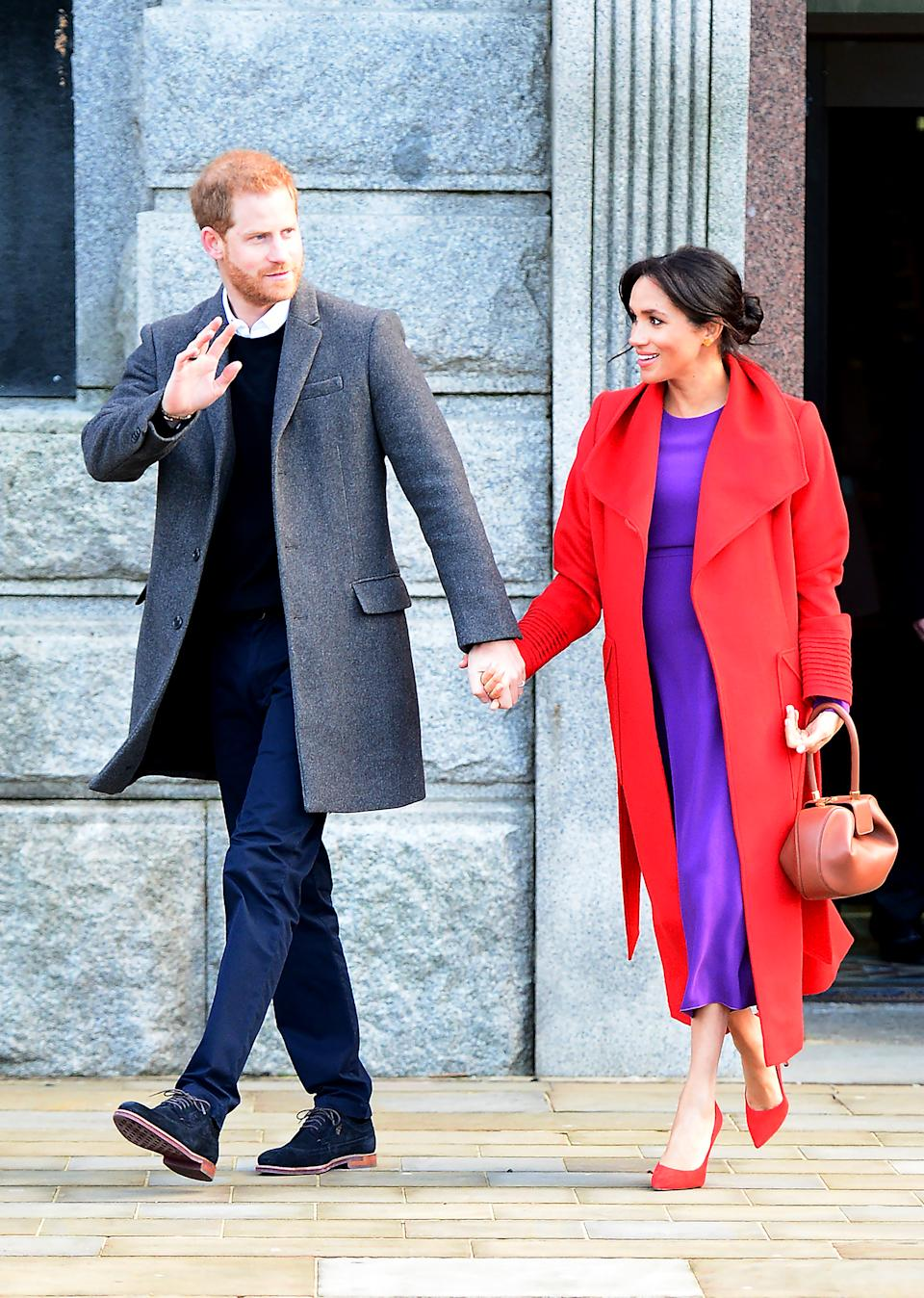 Wearing a Sentaler dress and an Aritzia coat with a Gabriella Hearst bag. (Getty Images)