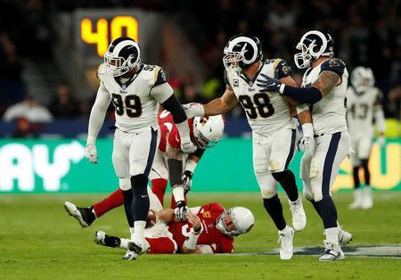 FILE PHOTO - NFL Football - Los Angeles Rams vs Arizona Cardinals - NFL International Series - Twickenham Stadium, London, Britain - October 22, 2017 LA Rams' Aaron Donald (L) celebrates after sacking Arizona Cardinals' Carson Palmer Action Images via Reuters/Andrew Boyers
