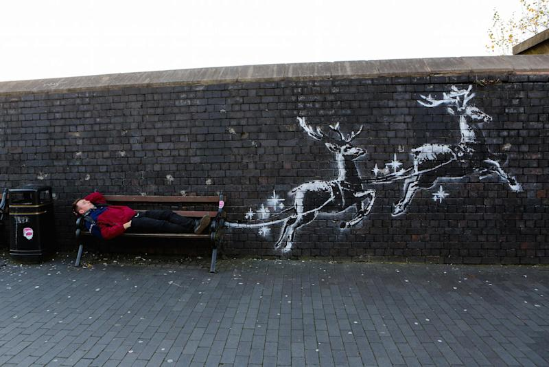 The mural shows reindeer pulling a bench in an effort to highlight homelessness (Picture: SWNS)