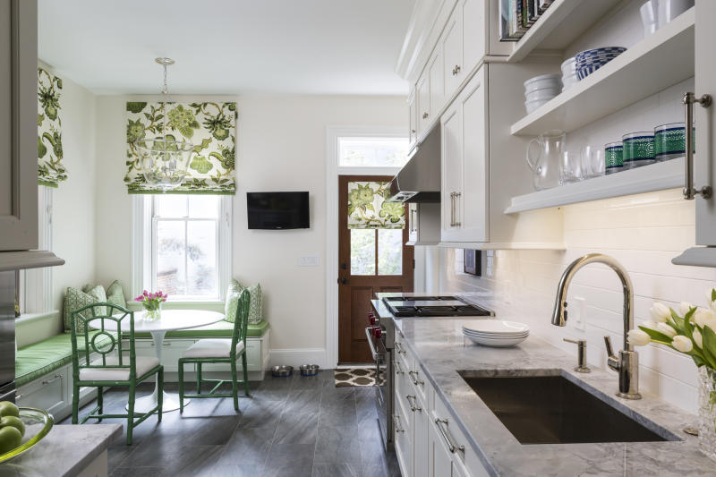 This photo provided by Marika Meyer Interiors shows a kitchen in Washington, D.C. Shades of blue were popular in 2018, says designer Marika Meyer, but she sees a growing trend toward decorating with shades of green, as seen in this Washington, D.C. area breakfast nook designed by Meyer in a kitchen by Aidan Design. (Angie Seckinger/Marika Meyer Interiors via AP)