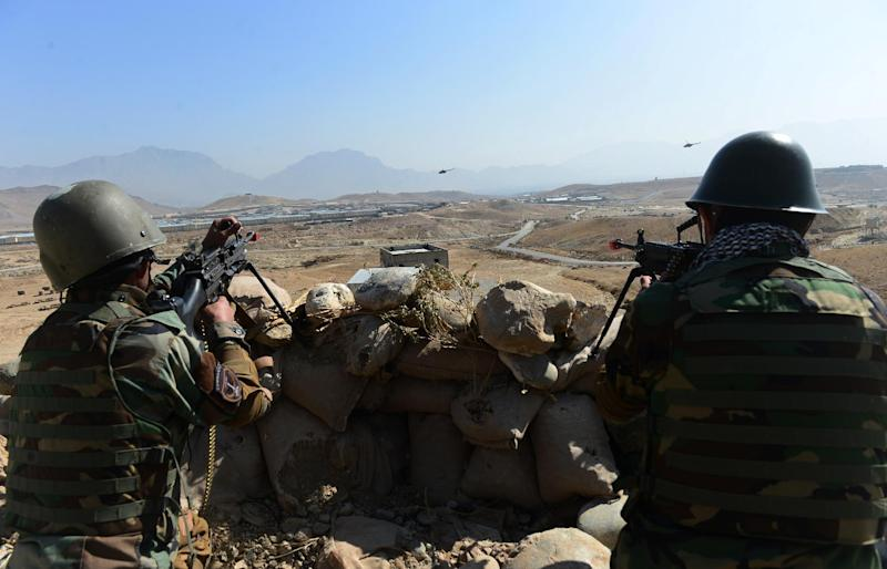 Afghan National Army soldiers keep watch during a combat training exercise at the Afghan National Military training center in Kabul on October 22, 2014