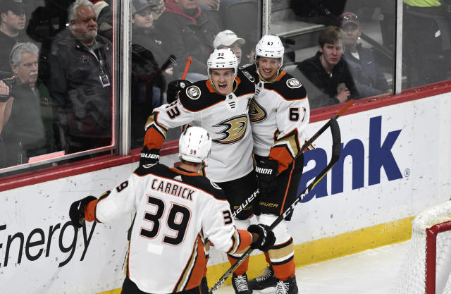Anaheim Ducks' Rickard Rakell, right, of Sweden, celebrates with teammates Jakob Silfverberg, center, of Sweden and Sam Carrick (39) in the first period of an NHL hockey game against the Minnesota Wild, Tuesday, Dec. 10, 2019, in St. Paul, Minn. (AP Photo/Tom Olmscheid)