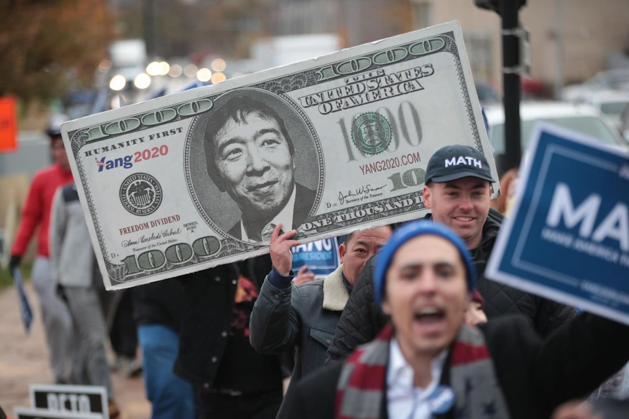 Supporters of Democratic presidential candidate Andrew Yang march outside the Wells Fargo Arena before the start of the Liberty and Justice Celebration in Des Moines. (Photo: Scott Olson/Getty Images)