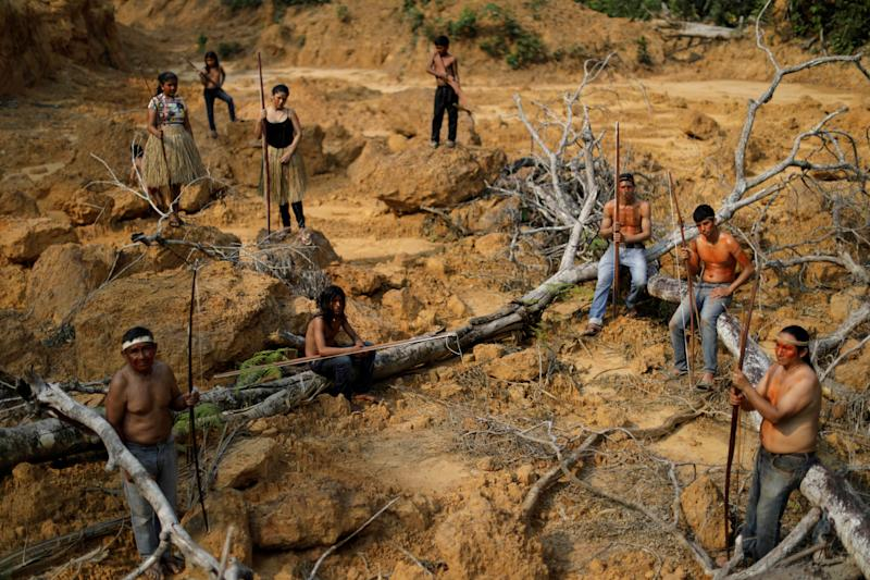 Indigenous people from the Mura tribe show a deforested area in unmarked indigenous lands inside the Amazon rainforest near Humaita, Amazonas State, Brazil August 20, 2019. Picture taken August 20, 2019. REUTERS/Ueslei Marcelino