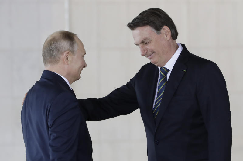 Brazil's President Jair Bolsonaro, right, welcomes Russia's President Vladimir Putin to a meeting of leaders of the BRICS emerging economies at the Itamaraty palace in Brasilia, Brazil, Thursday, Nov. 14, 2019. (AP Photo /Eraldo Peres)