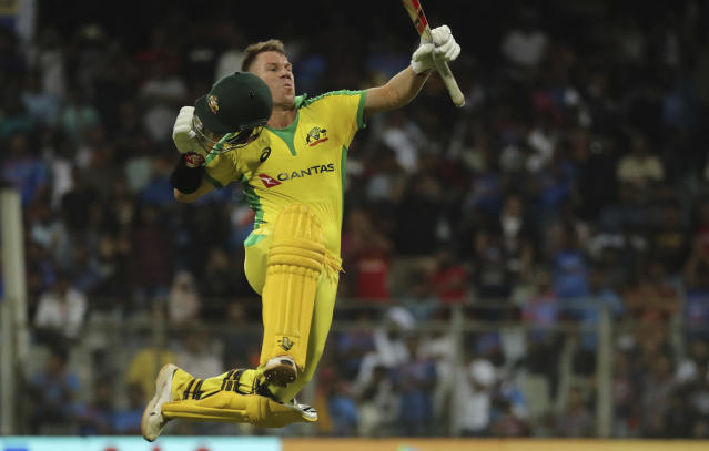 Australia's David Warner celebrates after scoring a hundred during the first one-day international cricket match between India and Australia in Mumbai, India, Tuesday, Jan. 14, 2020. (AP Photo/Rafiq Maqbool)