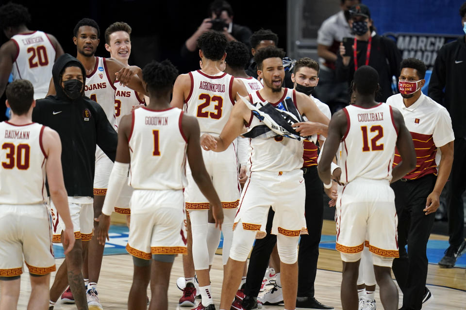 Southern California players celebrate after a Sweet 16 game against Oregon in the NCAA men's college basketball tournament at Bankers Life Fieldhouse, Sunday, March 28, 2021, in Indianapolis. Southern California won 82-68. (AP Photo/Jeff Roberson)