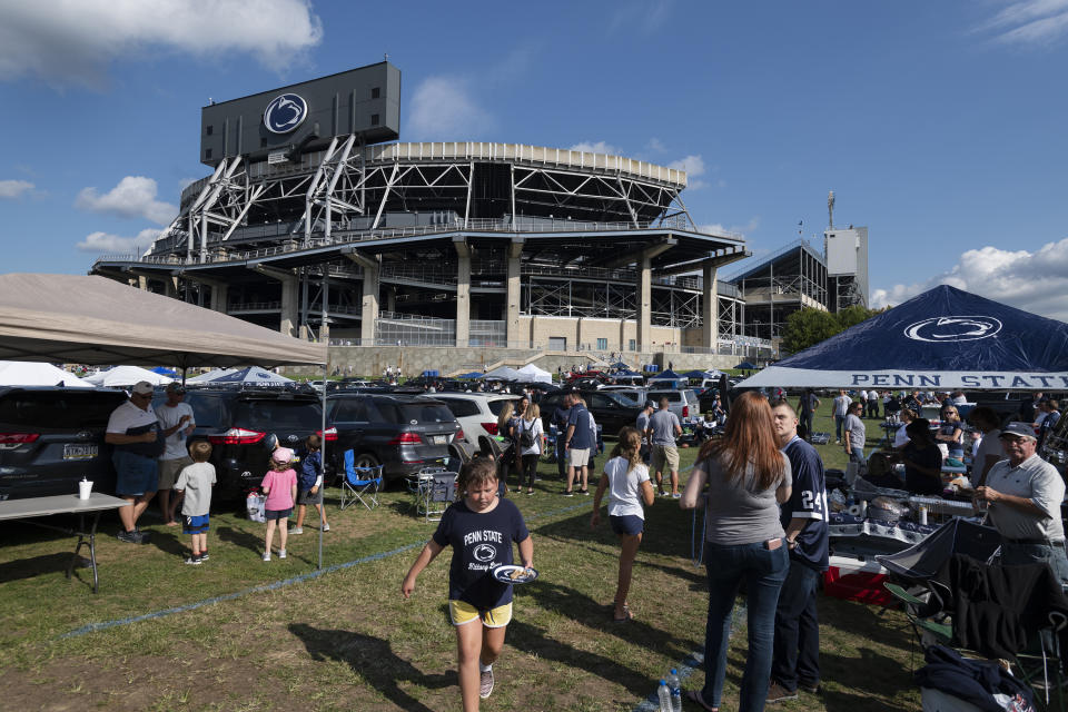 Fans tailgate outside of Beaver Stadium before an NCAA college football game between Penn State and Buffalo in State College, Pa., on Saturday, Sept. 7, 2019. (AP Photo/Barry Reeger)