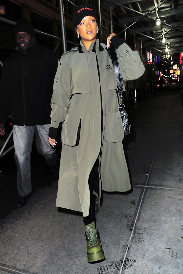 <p>In an all black outfit under a custom Ulyana Sergeenko <span></span>olive trench coat with a black cap and green Fenty x Puma boots while out in New York City.</p>