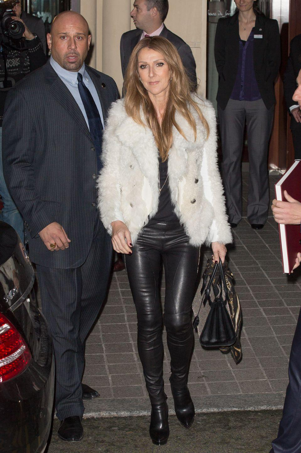 <p>In a white fur jacket and black leather pants while out in Paris. </p>