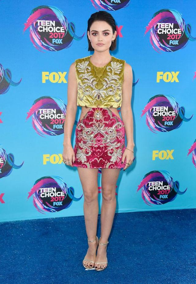 <p>Hale is putting <i>Pretty Little Liars</i> behind her with this mature and chic cut-out dress. Her slicked back hair puts her eyes center stage. (Photo: Getty Images) </p>