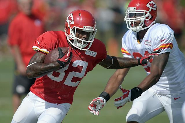 Kansas City Chiefs receiver Dwayne Bowe (82) runs past a defender during an NFL football training camp Monday, July 28, 2014, on the Missouri Western State University campus in St. Joseph, Mo. (AP Photo/The St. Joseph News-Press, Todd Weddle)
