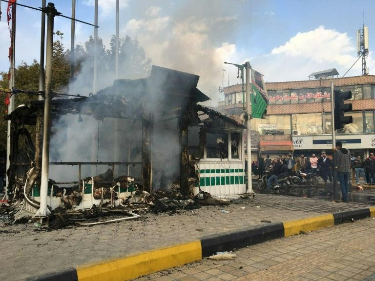 Iranian security force targets have come under attack by protesters in several cities, like this police station in the central city of Isfahan