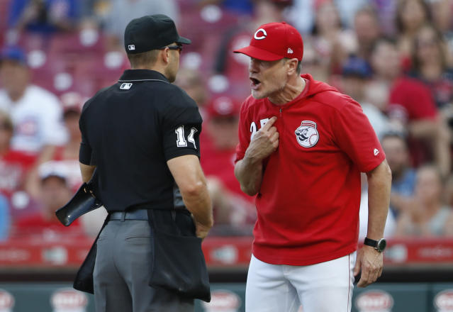 Cincinnati Reds manager David Bell (25) argues with home plate umpire Mark Wegner over whether Reds batter Jose Peraza was hit by a Chicago Cubs pitch during the ninth inning of a baseball game Saturday, June 29, 2019, in Cincinnati. Bell was ejected. The Cubs won 6-0. (AP Photo/Gary Landers)