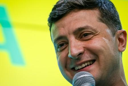 Ukraine's President Volodymyr Zelenskiy speaks at his party's headquarters after a parliamentary election in Kiev