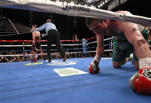Matthew Macklin, of the United Kingdom, gets up after being knocked down during the 11th round of a World Middleweight Championship boxing match against Sergio Martinez, of Argentina, Saturday, March 17, 2012, in New York. Martinez won when the fight was stopped after the 11th round. (AP Photo/Frank Franklin II)