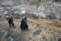 A roaring deluge of water swept away around 200 people in India's Uttarakhand state on February 7