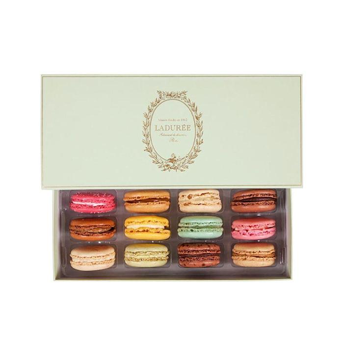 """<p><strong>Ladurée </strong></p><p>goldbelly.com</p><p><strong>$45.50</strong></p><p><a href=""""https://laduree.goldbelly.com/incontournable-box-of-12-macarons?ref=collection"""" rel=""""nofollow noopener"""" target=""""_blank"""" data-ylk=""""slk:Shop Now"""" class=""""link rapid-noclick-resp"""">Shop Now</a></p><p>This seasonal variety of Ladurée's famous macarons is almost too pretty to eat but will surely satisfy her sweet tooth.</p>"""