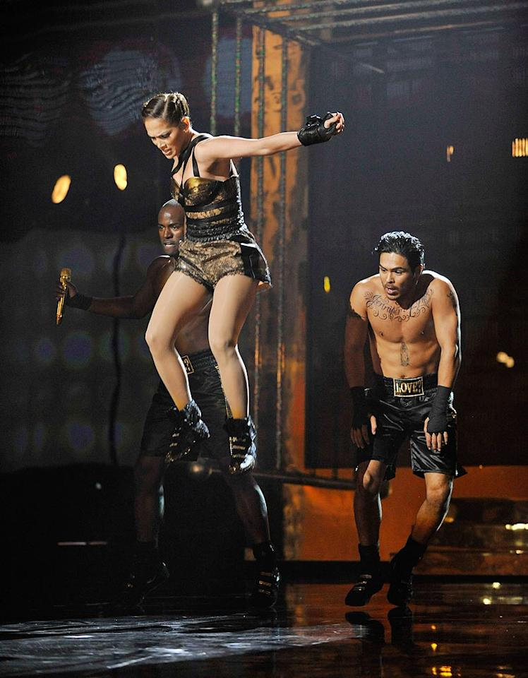 "Fellow hitmaker Jennifer Lopez inspired laughs on Sunday when she slipped and fell on her ample booty after climbing atop her dancers at the American Music Awards. ""The guys' backs were a little bit sweaty,"" she joked later to ""Access Hollywood."" Kevin Mazur/AMA2009/<a href=""http://www.wireimage.com"" target=""new"">WireImage.com</a> - November 22, 2009"
