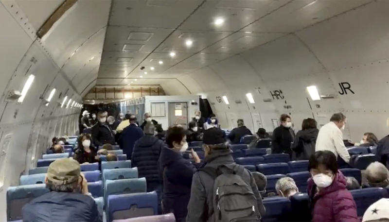 In this image from a video taken on Monday, Feb. 17, 2020, U.S. passengers who evacuated off the quarantined cruise ship the Diamond Princess, 
