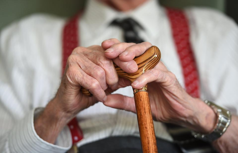 Elderly man with walking stick (PA Archive)