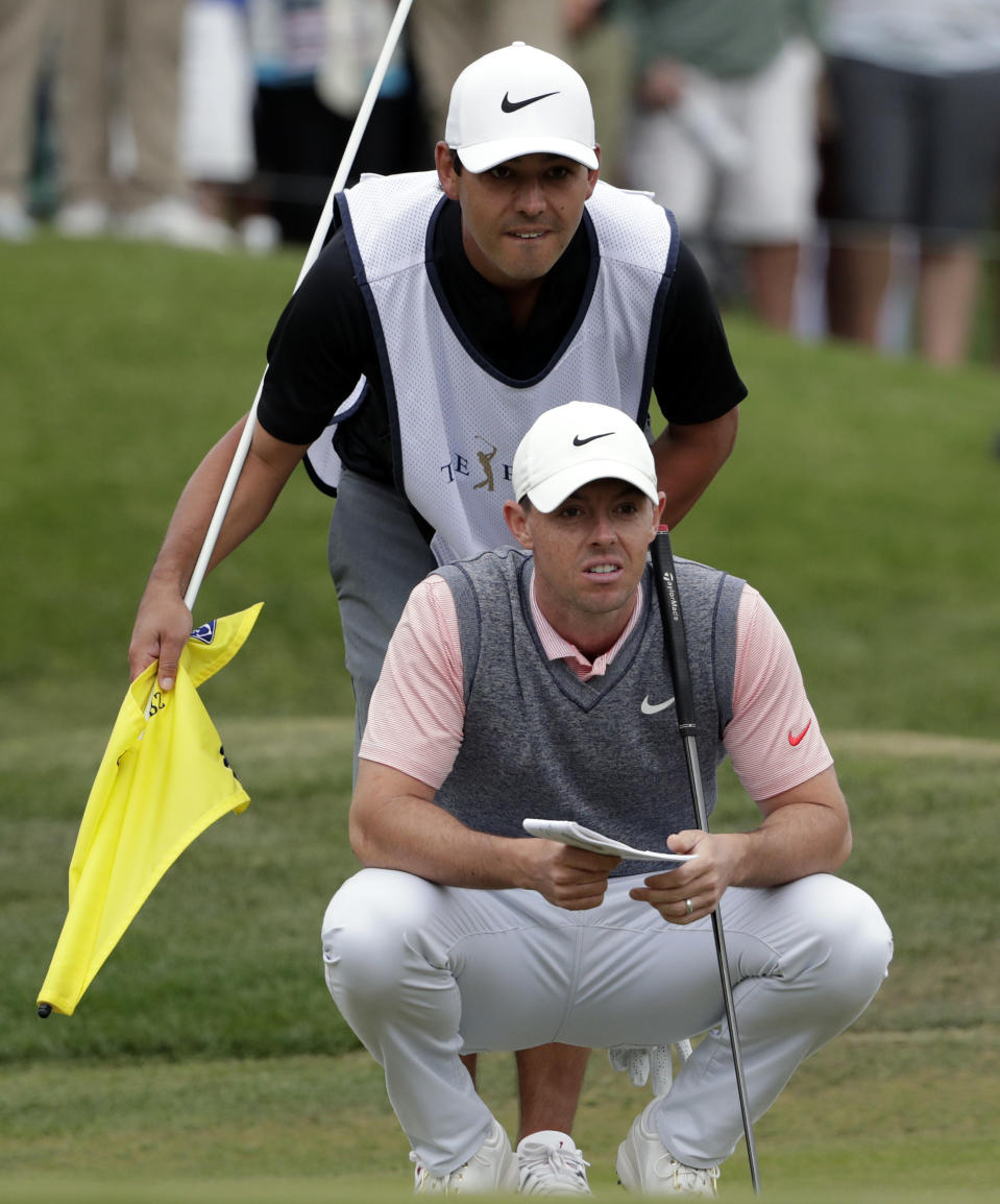 FILE - In this March 16, 2019, file photo, Rory McIlroy, of Northern Ireland, and his caddie Harry Diamond line up a putt on the ninth hole during the third round of The Players Championship golf tournament in Ponte Vedra Beach, Fla. Diamond is staying in McIlroy's guest house in Florida for his 14-day quarantine before returning to work at Colonial. (AP Photo/Lynne Sladky, File)
