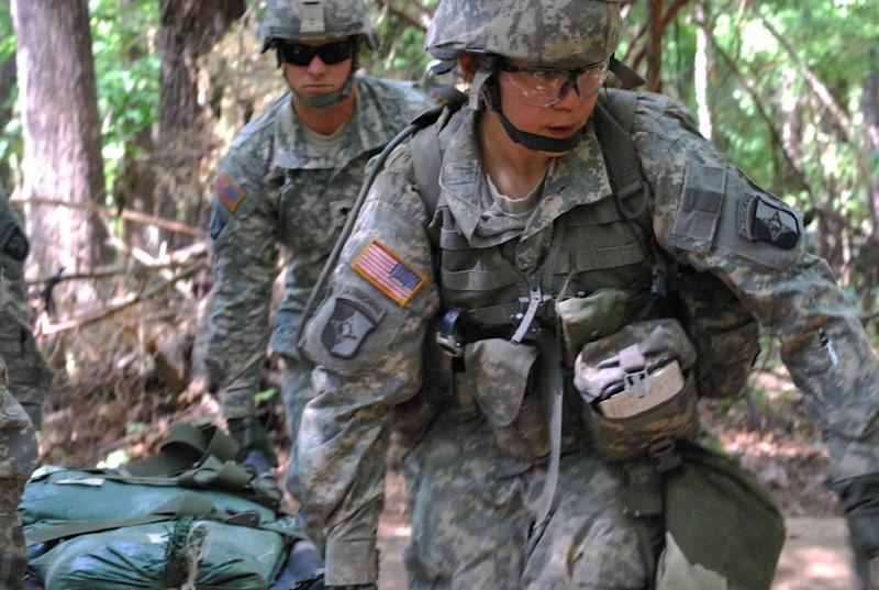 In a May 9, 2012 photo, Capt. Sara Rodriguez, 26, of the 101st Airborne Division, carries a litter of sandbags during the Expert Field Medical Badge training at Fort Campbell, Ky. Female soldiers are moving into new jobs in once all-male units as the U.S. Army breaks down formal barriers in recognition of what's already happened in wars in Iraq and Afghanistan.   (AP Photo/Kristin M. Hall)