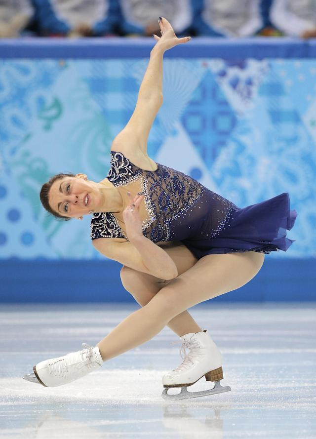 Jenna McCorkell of Britain competes in the women's team short program figure skating competition at the Iceberg Skating Palace during the 2014 Winter Olympics, Saturday, Feb. 8, 2014, in Sochi, Russia. (AP Photo/Vadim Ghirda)