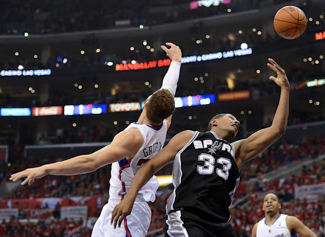 LOS ANGELES, CA - MAY 20: Boris Diaw #33 of the San Antonio Spurs goes up for a shot against Blake Griffin #32 of the Los Angeles Clippers in the first half in Game Four of the Western Conference Semifinals in the 2012 NBA Playoffs on May 20, 2011 at Staples Center in Los Angeles, California. NOTE TO USER: User expressly acknowledges and agrees that, by downloading and or using this photograph, User is consenting to the terms and conditions of the Getty Images License Agreement. (Photo by Harry How/Getty Images)