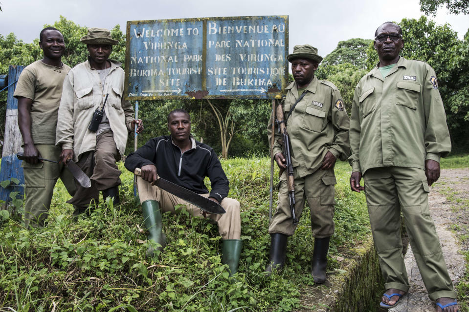VIRUNGA NATIONAL PARK, NORTH KIVU, DEMOCRATIC REPUBLIC OF CONGO - 2016/05/17: A group of rangers pause in front of a field post that is a starting base for a visit to mountain gorillas. The Virunga park, created in 1925 under the name of Albert National Park, has a 7,800 km2 superficy and is a UNESCO World Heritage Site. The park employs around 500 rangers who fight against poachers and illegal charcoal producers. (Photo by Thierry Falise/LightRocket via Getty Images)
