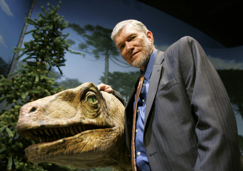 "FILE - In this May 24, 2007 file photo, Ken Ham, founder of the nonprofit ministry Answers in Genesis, poses with one of his favorite animatronic dinosaurs during a tour of the Creation Museum in Petersburg, Ky. Ham, who recently debated evolution with TV's ""Science Guy"" Bill Nye, says fundraising after the widely watched event helped to revive stalled plans to build a 510-foot replica of Noah's Ark. (AP Photo/Ed Reinke, File)"