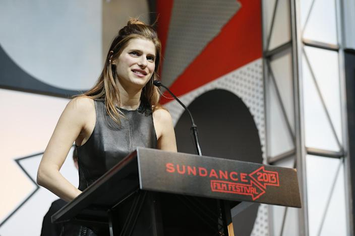 """FILE - In this Jan. 26, 2013 file photo, writer-director and actress Lake Bell accepts her U.S. Dramatic Waldo Salt Screenwriting Award for """"In A World..."""" during the 2013 Sundance Film Festival Awards Ceremony in Park City, Utah. The film, which opens Friday, is the directorial debut for Bell, the 34-year-old actress of TV shows like """"Boston Legal,"""" films like """"No Strings Attached"""" and, increasingly, comedy like Rob Corddry's """"Children's Hospital."""" (Photo by Danny Moloshok/Invision/AP, File)"""