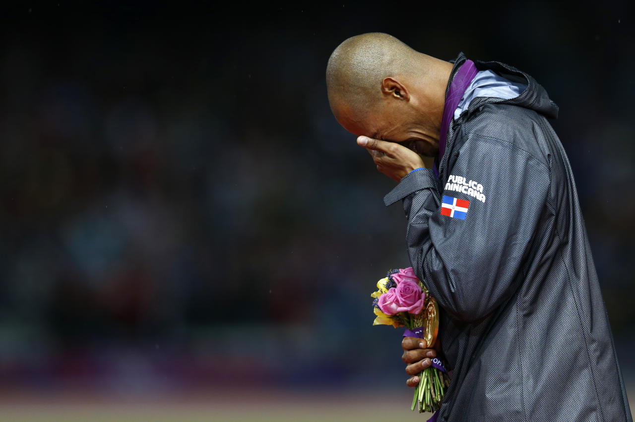 Felix Sanchez of the Dominican Republic cries after receiving his gold medal during the men's 400m hurdles victory ceremony at the London 2012 Olympic Games at the Olympic Stadium August 6, 2012.   REUTERS/Eddie Keogh (BRITAIN  - Tags: SPORT OLYMPICS SPORT ATHLETICS TPX IMAGES OF THE DAY)