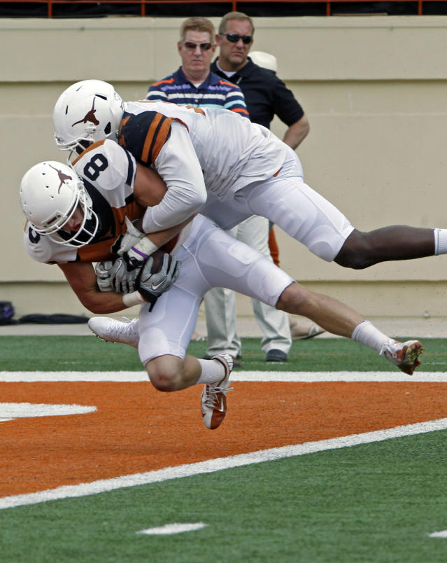Texas receiver Jaxon Shipley (8) catches a touchdown pass against Chevoski Collins during the second half of the Orange and White spring NCAA college football game on Saturday, April 19, 2014, in Austin, Texas. (AP Photo/Michael Thomas)