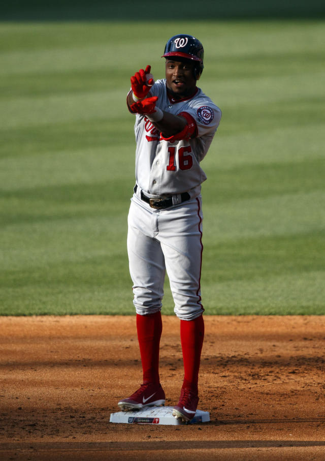 Washington Nationals' Victor Robles celebrates after hitting a two-run single off Philadelphia Phillies starting pitcher Nick Pivetta during the second inning of a baseball game, Friday, July 12, 2019, in Philadelphia. Robles advanced to second base on a fielding error by Phillies catcher Andrew Knapp. (AP Photo/Matt Slocum)