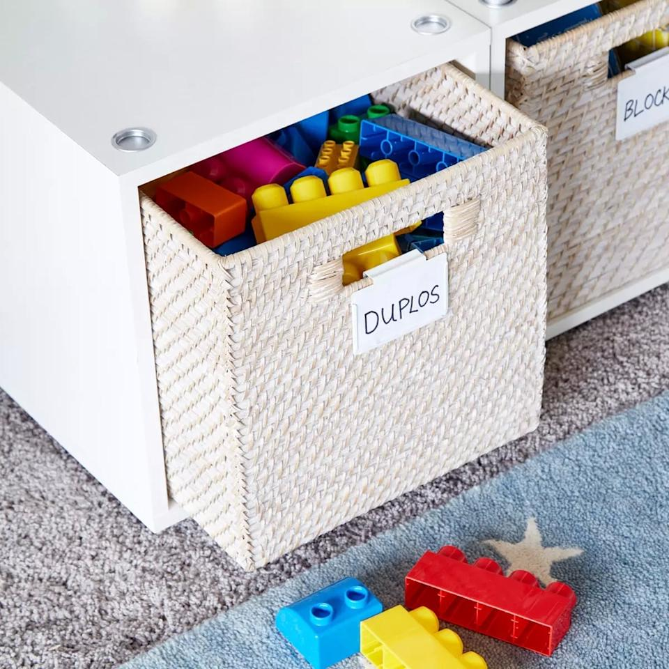"<p>Easy-access storage like this <a rel=""nofollow"" href=""https://www.popsugar.com/buy/Rattan%20Cube%20Whitewash-404884?p_name=Rattan%20Cube%20Whitewash&retailer=containerstore.com&price=40&evar1=moms%3Aus&evar9=45674726&evar98=https%3A%2F%2Fwww.popsugar.com%2Fmoms%2Fphoto-gallery%2F45674726%2Fimage%2F45674736%2FRattan-Cube-Whitewash&list1=lego%2Cthe%20container%20store%2Ctoy%20organization%2Cmarie%20kondo&prop13=api&pdata=1"" rel=""nofollow"">Rattan Cube Whitewash</a> ($40) is ideal for toddlers who are just getting going with building.</p>"