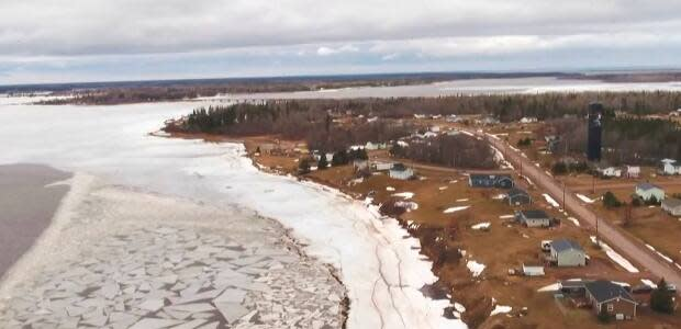 The ice around Lennox Island was not solid enough for the reconciliation event to take place along the traditional route. Participants walked the bridge instead.