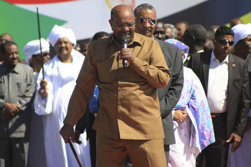 "Sudan's President Omar al-Bashir addresses supporters at a rally in Khartoum, Sudan, Wednesday, Jan. 9, 2019. Al-Bashir told the gathering of several thousands of supporters in the capital that he is ready to step down only ""through election."" The remarks come after three weeks of anti-government protests. (AP Photo/Mahmoud Hjaj)"