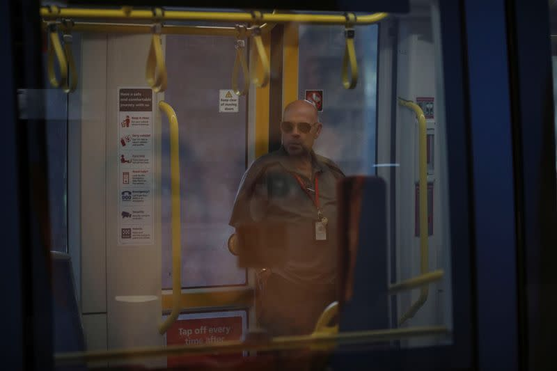 A man travels in an almost empty tram wagon during a workday following the implementation of stricter social-distancing and self-isolation rules to limit the spread of the coronavirus disease (COVID-19) in Sydney