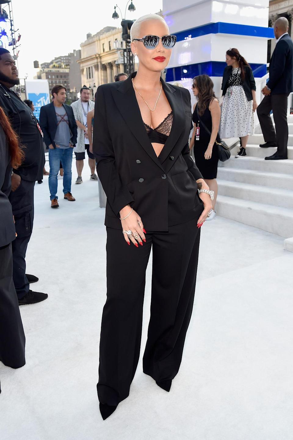 <p><b>Amber Rose revealing her bra in a black suit </b></p><p>Amber Rose was totally business in a black suit — and then decided to sex it up by wearing just a lace bra underneath. She also added some reflective sunglasses to fend off the sun (well, and shade). <i>(Photo: Getty Images)</i></p>