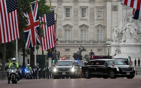 The convoy travelling down The Mall on Tuesday morning - Credit: Toby Melville/Reuters
